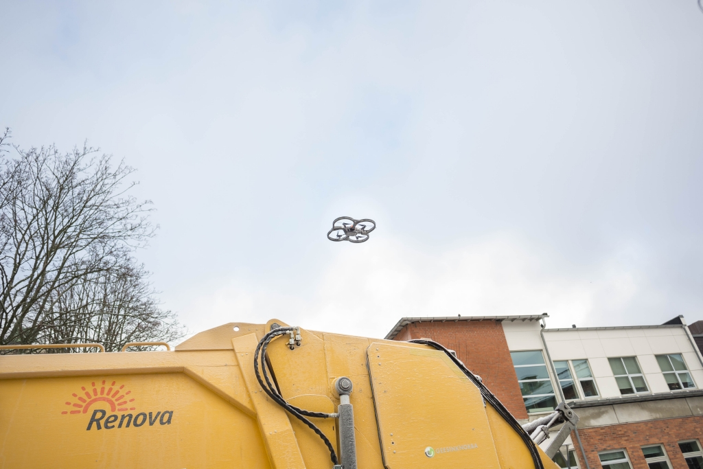 G2016-0012 A Drone, Garbage Truck and Robot Work in Sync to Collect Trash Bins