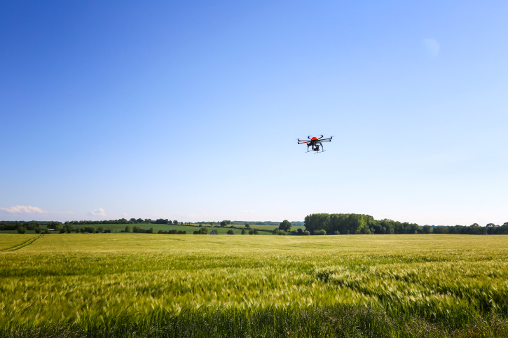 drone-over-field AIAA and Drone World Expo Launch UAS Research Competition