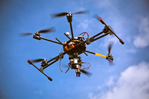 1119_drone_hexacopter_in_sky Universities Comment on FAA's sUAS Rulemaking