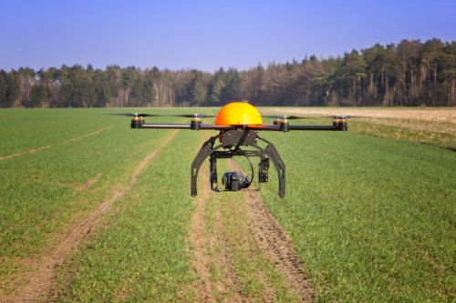 1235_drone_yellow_over_farm_field Amendment to Support Agricultural Use of UAVs Passes House