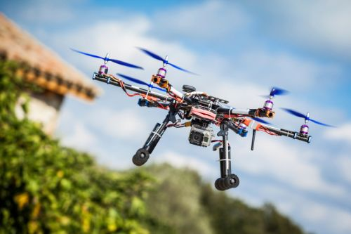 773_drone_next_to_house Senator Proposes Bill to Address UAS Privacy Concerns 'Before It's Too Late'