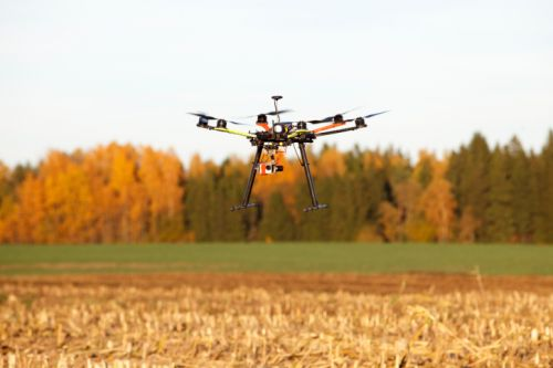 871_drone_over_orange_field Colorado UAS Technology Start-Up Wins State Grant