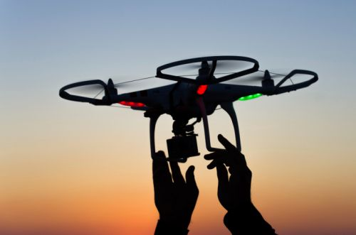 909_drone_holding_up_sunset FAA Finally Releases Proposed Small UAS Rules