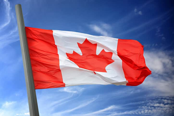 canadian flag blue sky