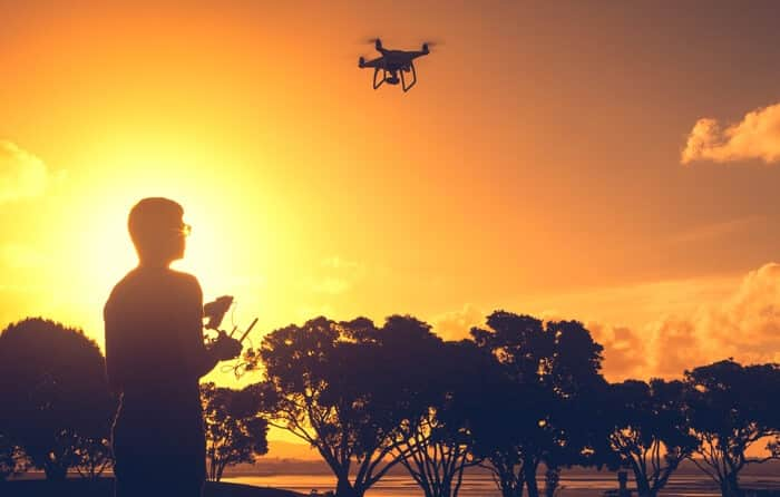 sunset flying drone