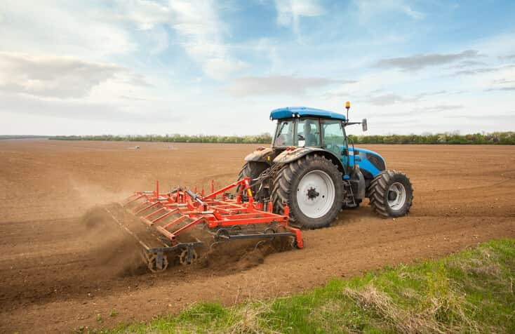 And theyre off deveron uas commences work for canadian farming agricultural scene farming with tractor and plow in field sciox Images